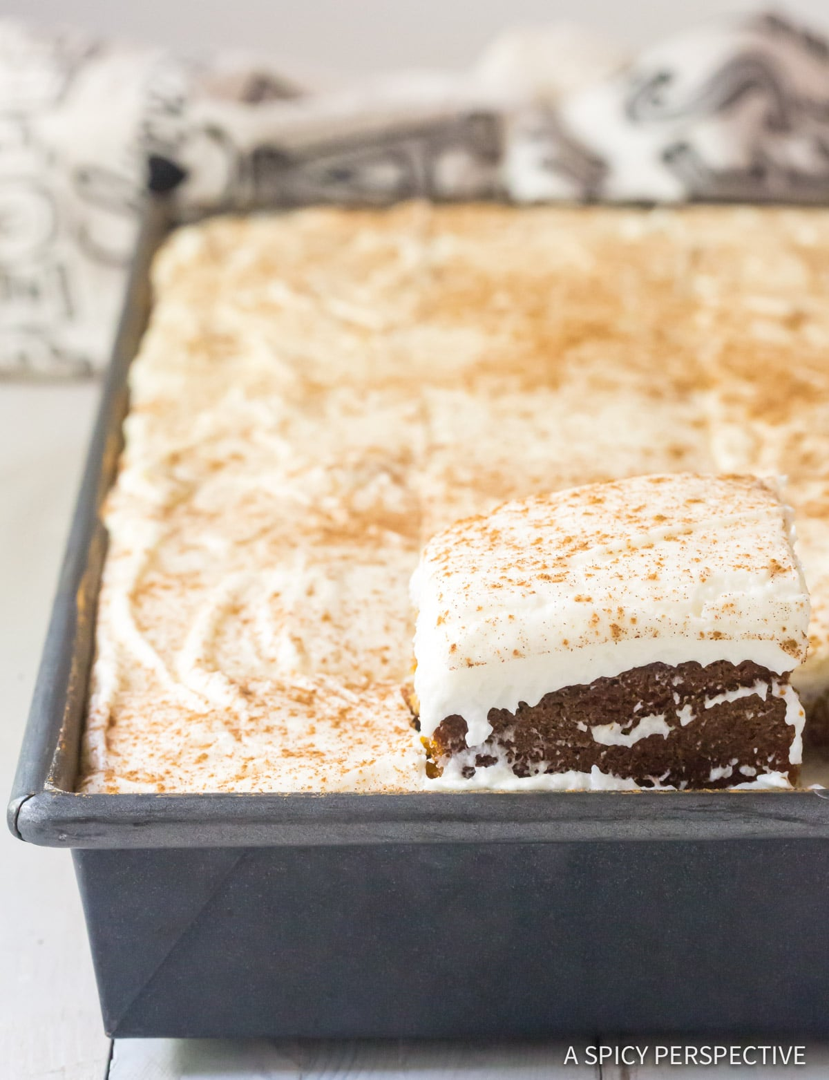Tender Pumpkin Texas Sheet Cake with Buttermilk Frosting Recipe #ASpicyPerspective