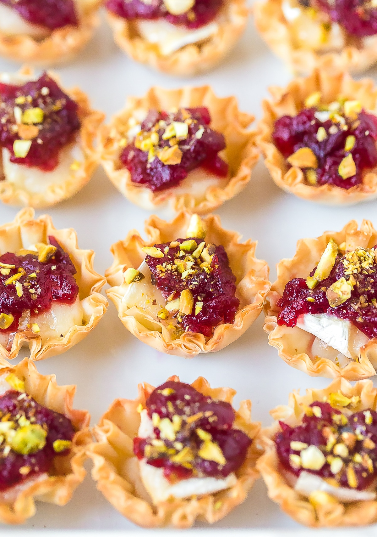 Baked Brie Bites with Cranberry Sauce Recipe #ASpicyPerspective #brie #baked #cranberry