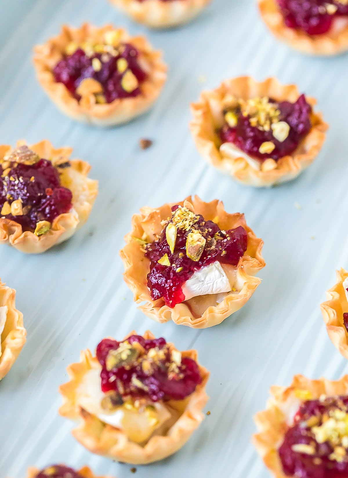 Mini Baked Brie Bites with Cranberry Sauce Recipe #ASpicyPerspective #brie #baked #cranberry