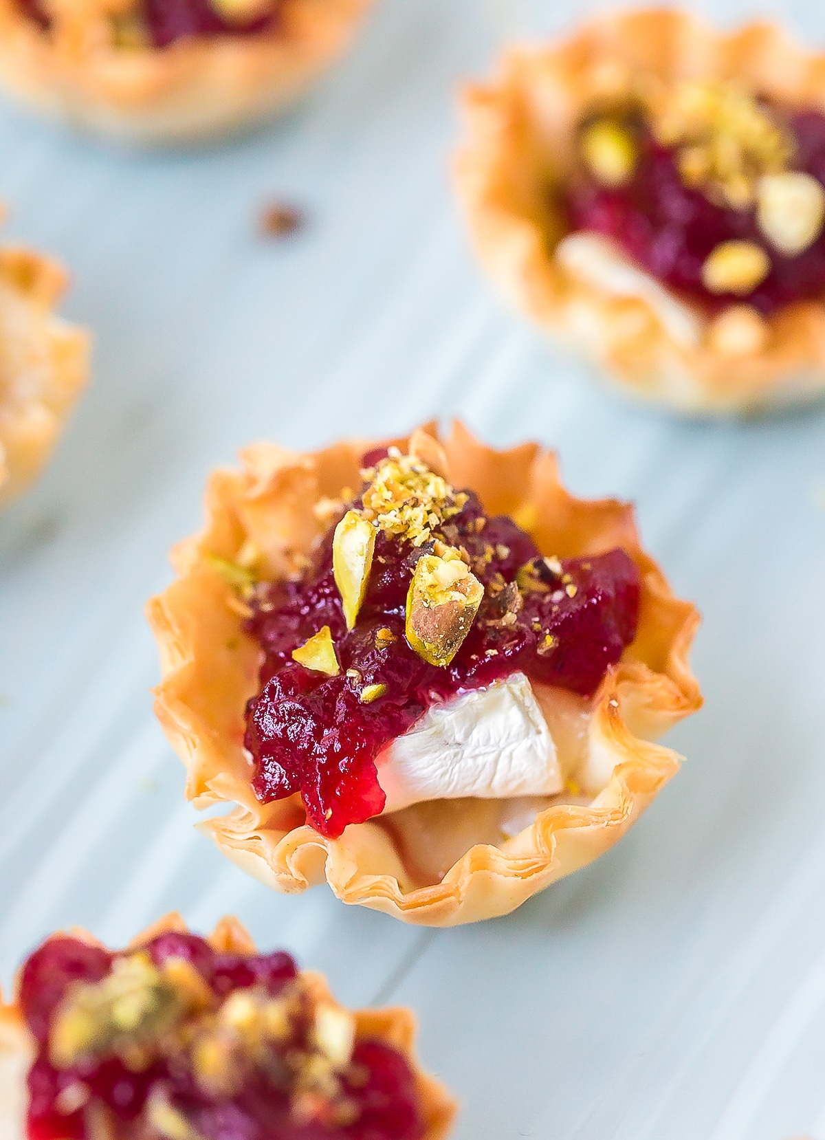 Easy Baked Brie Bites with Cranberry Sauce Recipe #ASpicyPerspective #brie #baked #cranberry