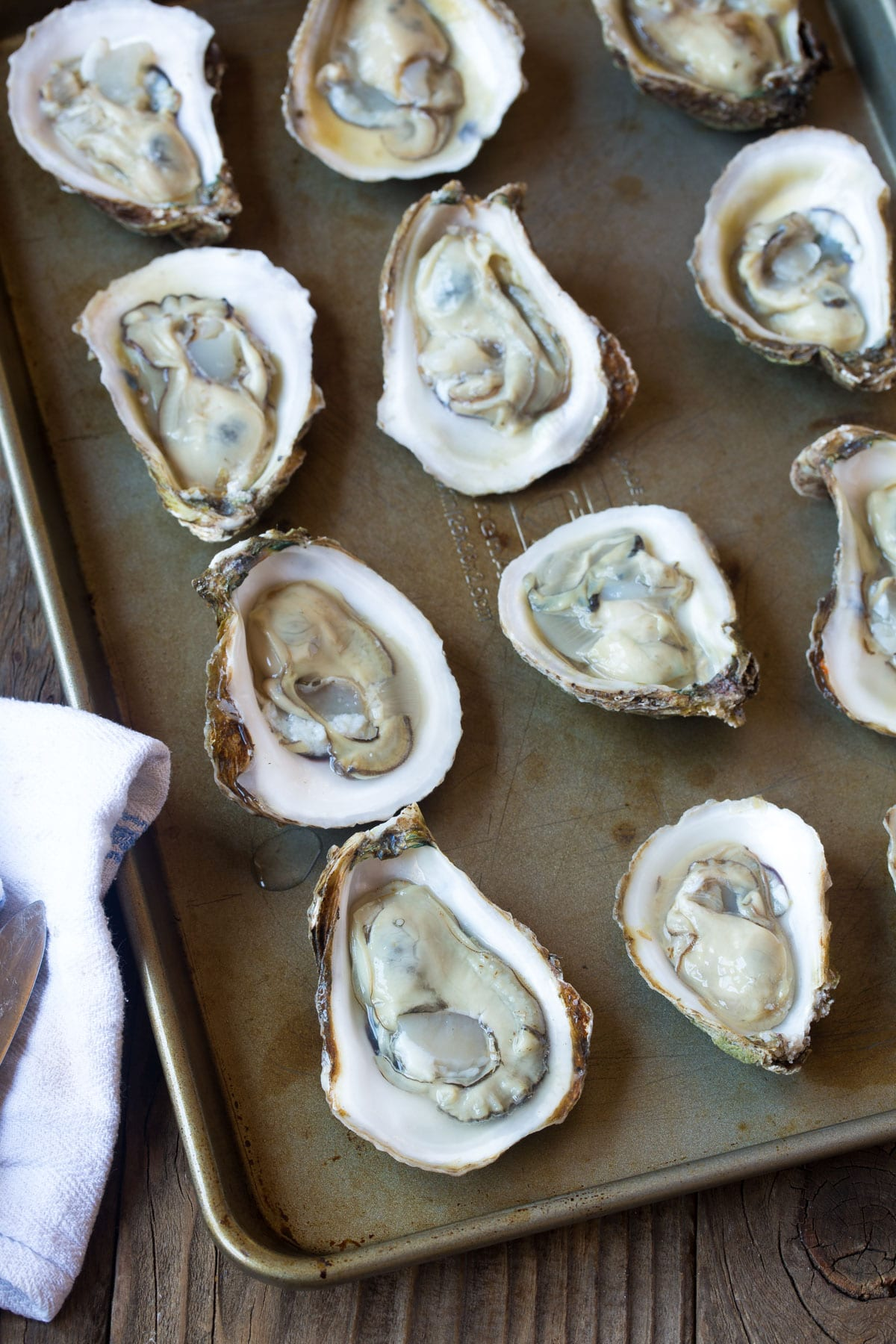 Perfect Three-Cheese Baked Oysters Recipe (In The Shell!) #ASpicyPerspective #holiday #newyears #christmas