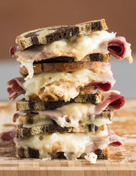 Baked Reuben Party Sandwiches Recipe #ASpicyPerspective #partysandwiches #bakedsandwiches