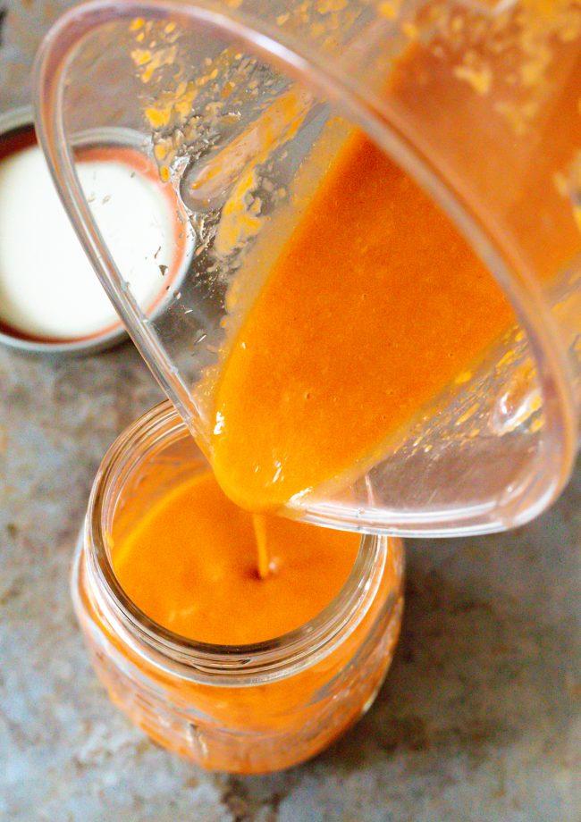 Pour salad dressing into jars