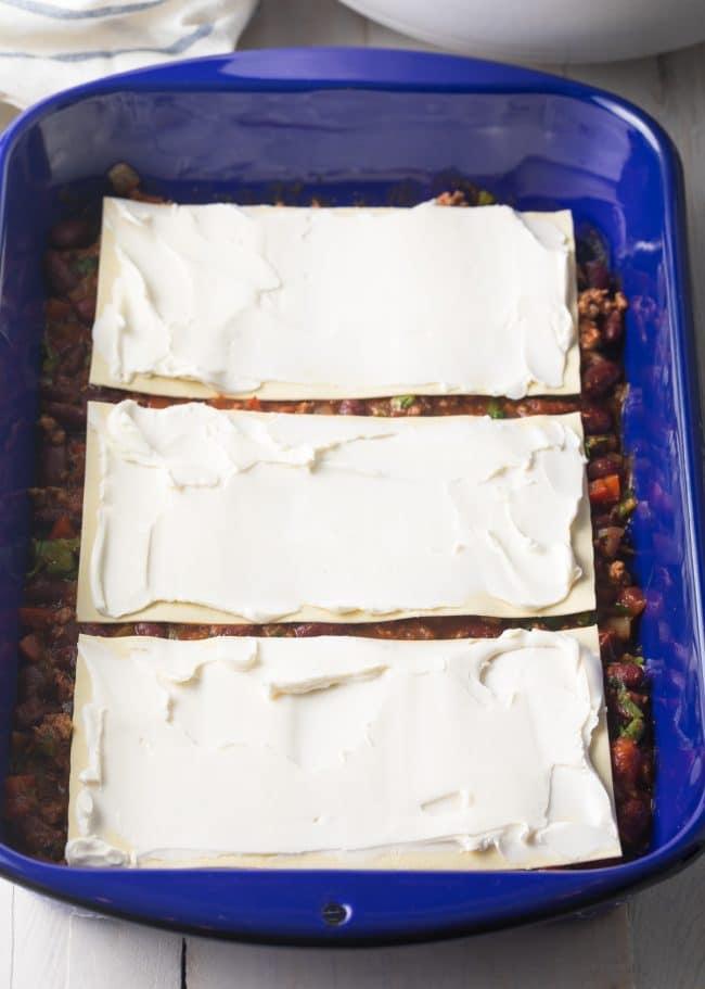 Layer 1 - Cowboy Chili Lasagna Recipe #ASpicyPerspective #lasagna #cowboy #chili