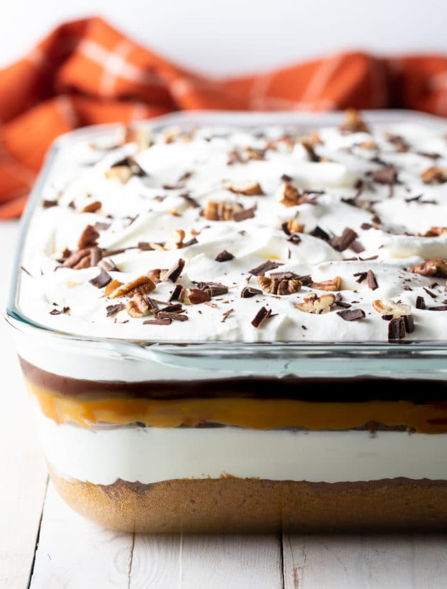 Layered Pumpkin Turtle Cheesecake Recipe #ASpicyPerspective #pumpkin #cheesecake #caramel #chocolate #holiday