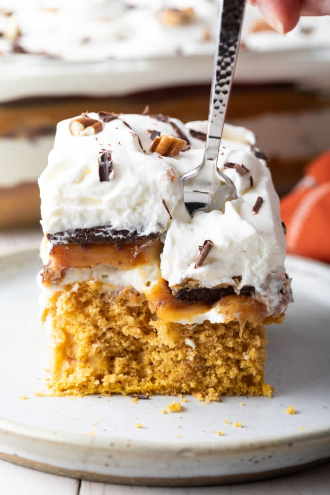 Layered Pumpkin Cheesecake Recipe #ASpicyPerspective #pumpkin #cheesecake #caramel #chocolate #holiday