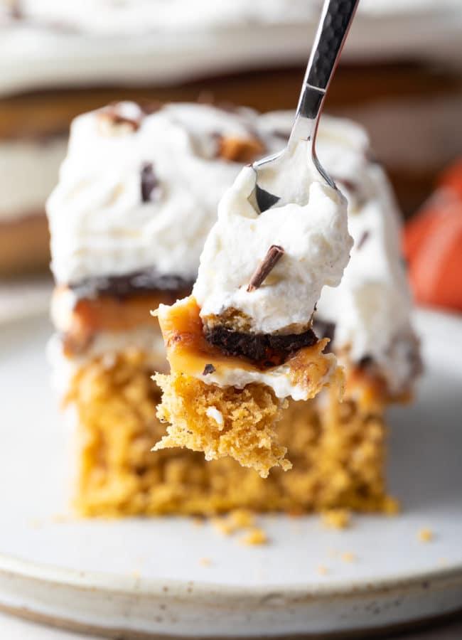 Layered Pumpkin Cake Recipe #ASpicyPerspective #pumpkin #cheesecake #caramel #chocolate #holiday
