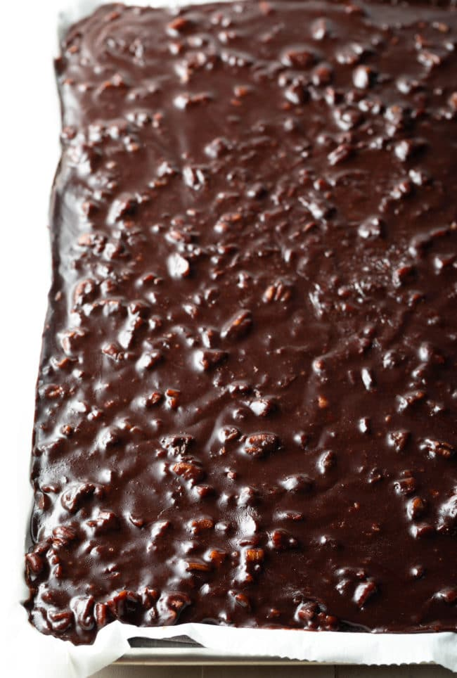 Classic Texas Sheet Cake Recipe #ASpicyPerspective #chocolate #cake #sheetcake #texas #pecan #tailgating #holiday #party #bakesale