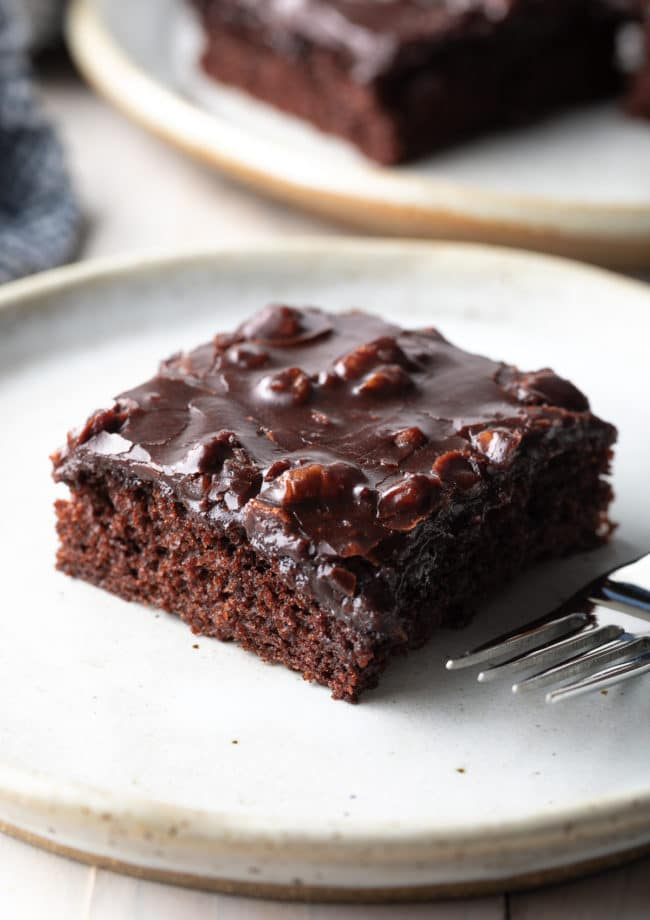 The Ultimate Texas Sheet Cake Recipe #ASpicyPerspective #chocolate #cake #sheetcake #texas #pecan #tailgating #holiday #party #bakesale