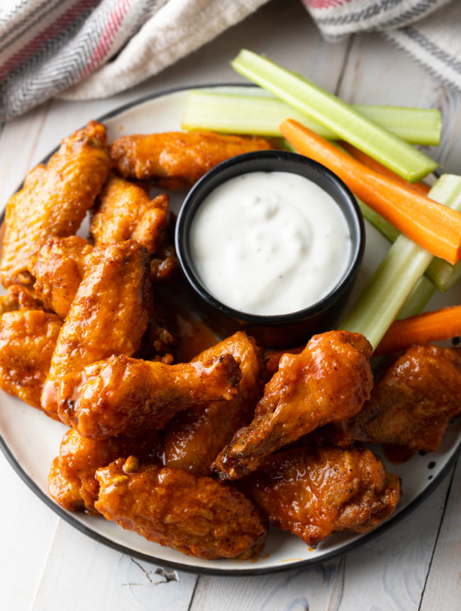 Crispy Baked Buffalo Wings Recipe (Learn How to Make the BEST Baked Chicken Wings in the Oven!) #ASpicyPerspective #chicken #wings #hot #buffalo #baked #crispy #best #superbowl #party