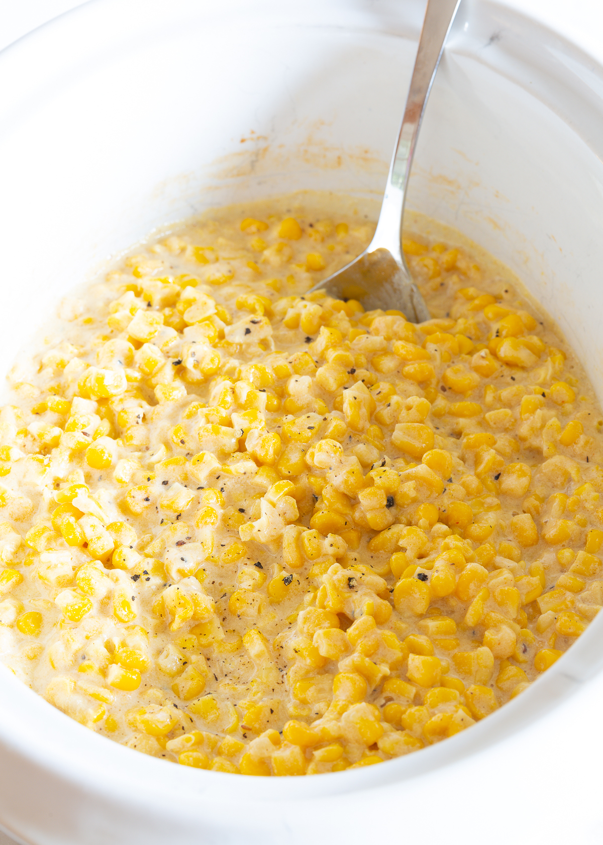 Crock Pot Creamed Corn Recipe #ASpicyPerspective #corn #thanksgiving #holidays #southern #crockpot #slowcooker