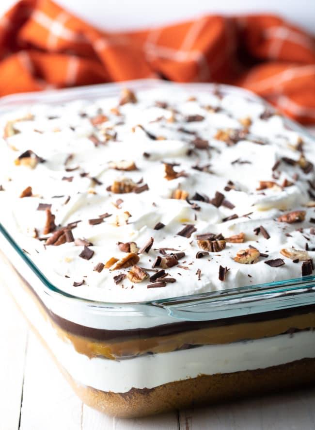 Party Dessert: Pumpkin Turtle Cheesecake Recipe #ASpicyPerspective #pumpkin #cheesecake #caramel #chocolate #holiday