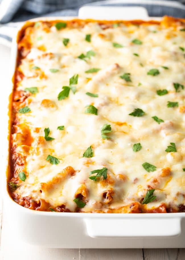 Easy Ricotta Baked Ziti with Sausage Recipe #ASpicyPerspective #baked #ziti #noboil #ricotta #pasta #italian #comfortfood #slowcooker #crockpot