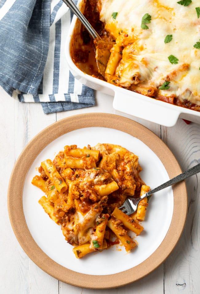 No-Boil Ricotta Baked Ziti with Sausage Recipe #ASpicyPerspective #baked #ziti #noboil #ricotta #pasta #italian #comfortfood #slowcooker #crockpot