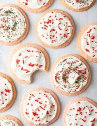 Peppermint Frosted Sugar Cookies Recipe: Soft Peppermint Cookies with Easy Cookie Frosting! This is a brilliant sugar cookie variation for the holidays! #ASpicyPerspective #cookies #sugarcookies #peppermint #mint #holidays #christmas #cookie