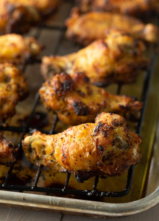 Crispy Lemon Pepper Chicken Wings Recipe #ASpicyPerspective #chicken #wings #lemon #lemonpepper #baked #lowcarb #keto #paleo #whole30 #superbowl