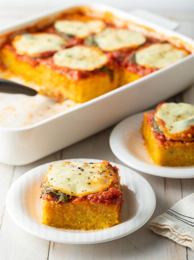 Easy Margherita Baked Polenta Recipe #ASpicyPerspective #polenta #italian #glutenfree #margherita #marinara #pesto #basil #mozzarella