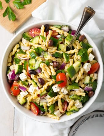 Easy Greek Pasta Salad Recipe #ASpicyPerspective #salad #pasta #healthy #vegetarian #cucumber #tomato #makeahead #mealprep