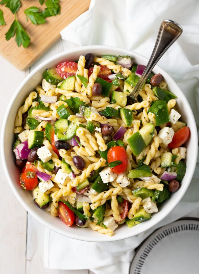 Easy Greek Pasta Salad Recipe #ASpicyPerspective #salad #pasta #healthy #vegetarian #cucumber #tomato #makeahead #mealprep