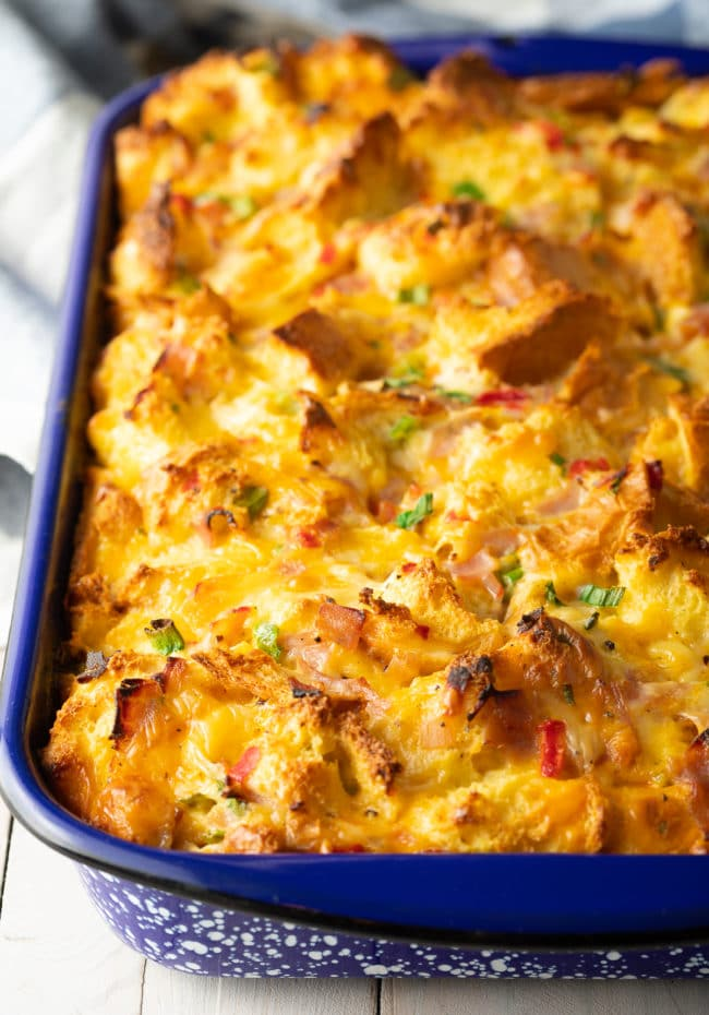 How To Make Overnight Breakfast Strata + Video! #ASpicyPerspective #egg #ham #cheese #breakfast #strata #casserole #overnight