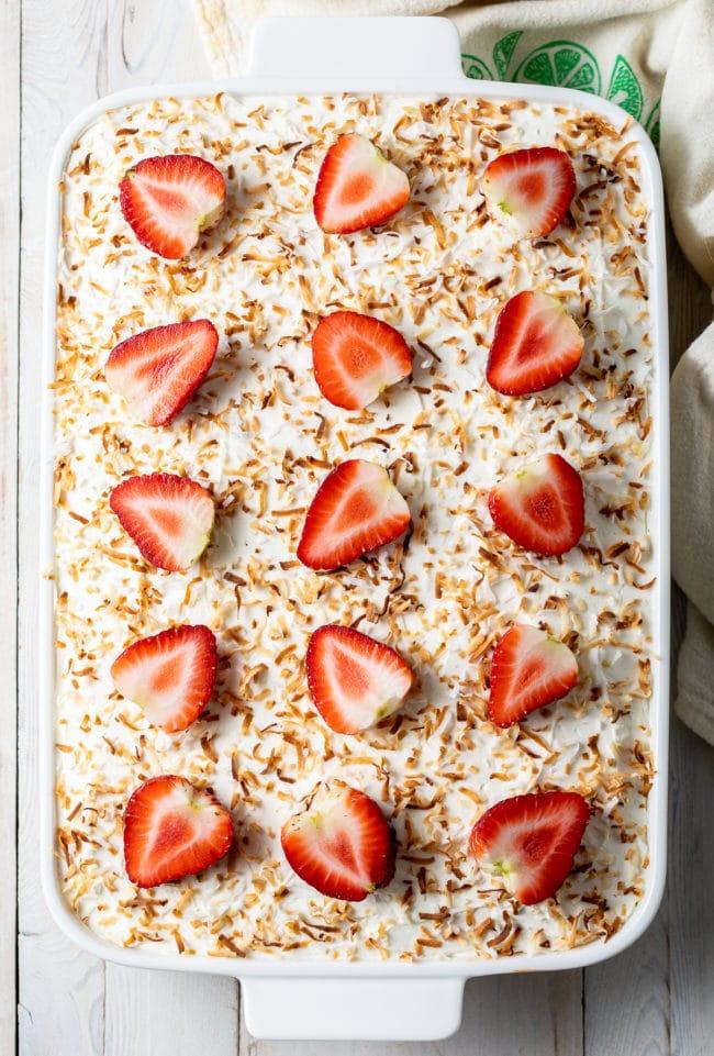 Strawberry Jello Poke Cake Recipe #ASpicyPerspective #cake #poke #jello #southern #strawberry #pineapple #coconut #pinacolada #holiday #easter #summer #dessert