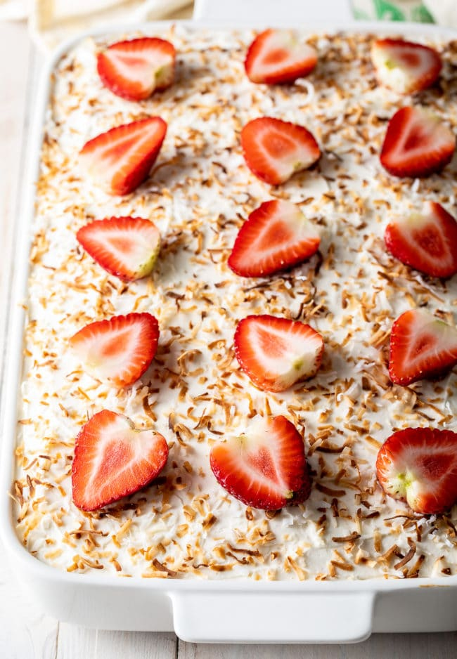 Strawberry Cake Recipe #ASpicyPerspective #cake #poke #jello #southern #strawberry #pineapple #coconut #pinacolada #holiday #easter #summer #dessert