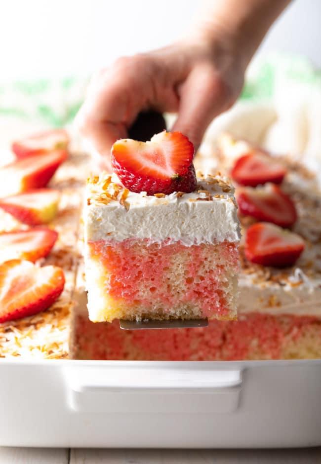 Easy Poke Cake Recipe #ASpicyPerspective #cake #poke #jello #southern #strawberry #pineapple #coconut #pinacolada #holiday #easter #summer #dessert
