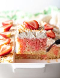 Strawberry-Colada Jello Poke Cake Recipe #ASpicyPerspective #cake #poke #jello #southern #strawberry #pineapple #coconut #pinacolada #holiday #easter #summer #dessert