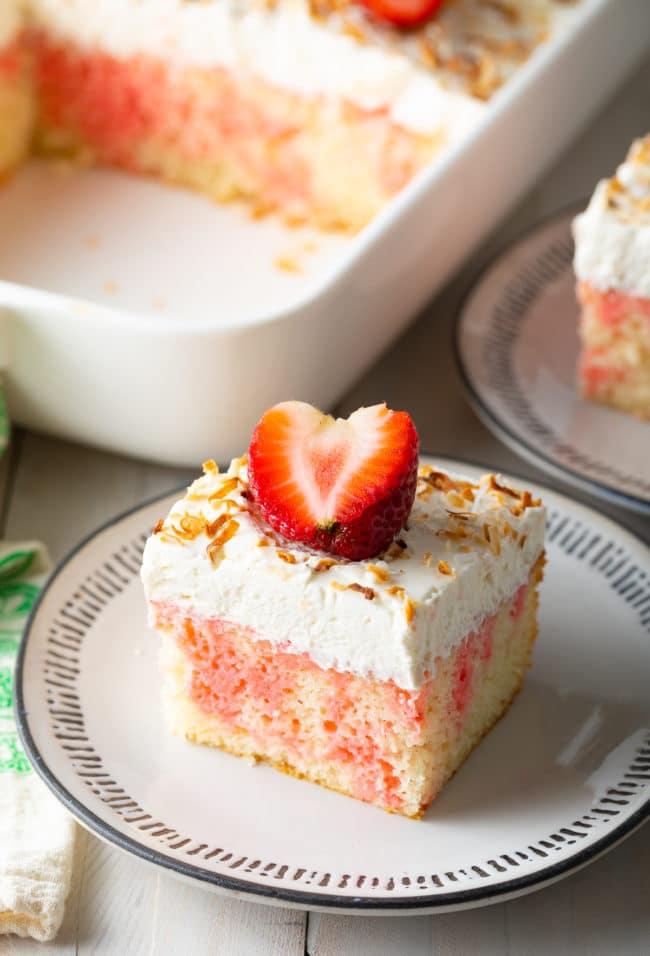 Strawberry Poke Cake Recipe #ASpicyPerspective #cake #poke #jello #southern #strawberry #pineapple #coconut #pinacolada #holiday #easter #summer #dessert