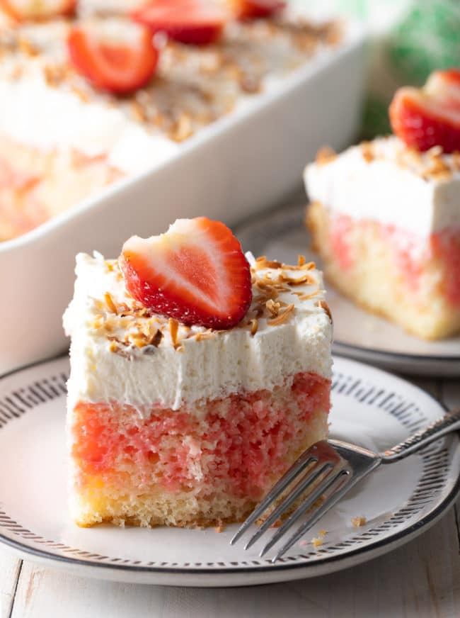 Easy Strawberry Cake Recipe #ASpicyPerspective #cake #poke #jello #southern #strawberry #pineapple #coconut #pinacolada #holiday #easter #summer #dessert