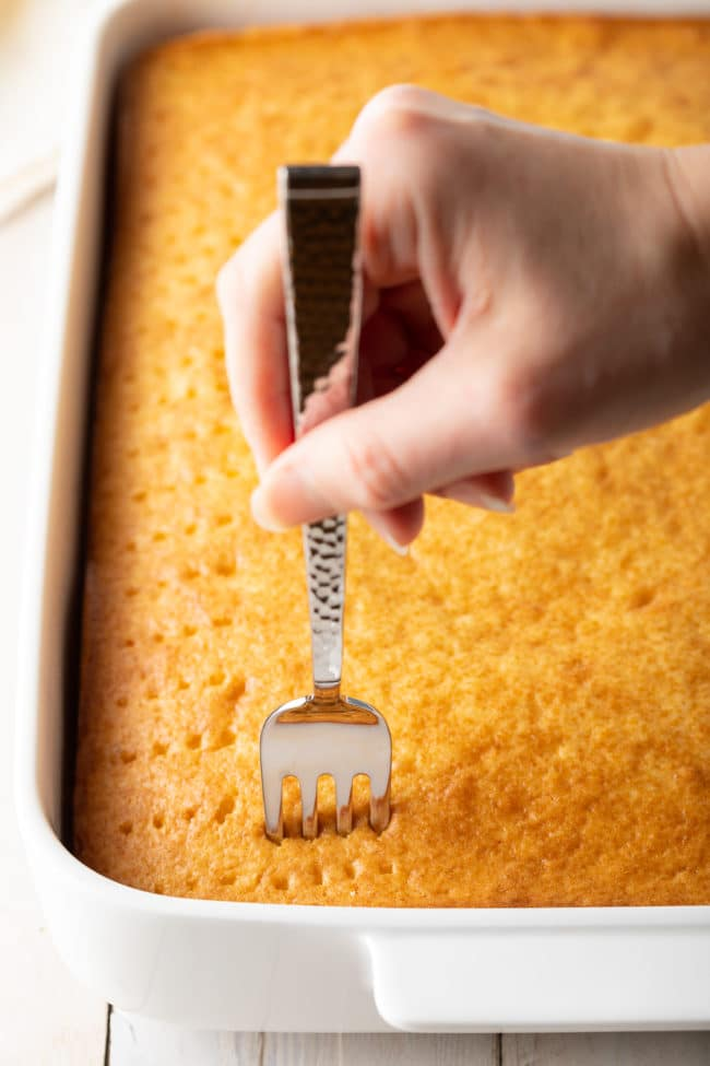 How To Make Poke Cake (Recipe) #ASpicyPerspective #cake #poke #jello #southern #strawberry #pineapple #coconut #pinacolada #holiday #easter #summer #dessert