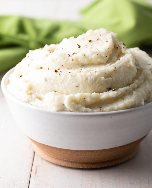 Cauliflower Mashed Potatoes Recipe #ASpicyPerspective #lowcarb #keto #glutenfree #cauliflower #mash #potato #healthy