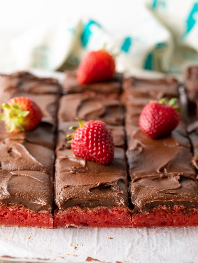 rich and gooey strawberry brownies (cake mix!) with chocolate fudge frosting