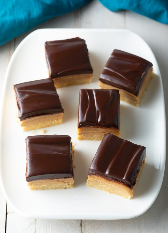 layered chocolate, peanut butter caramel, shortbread cookie bars