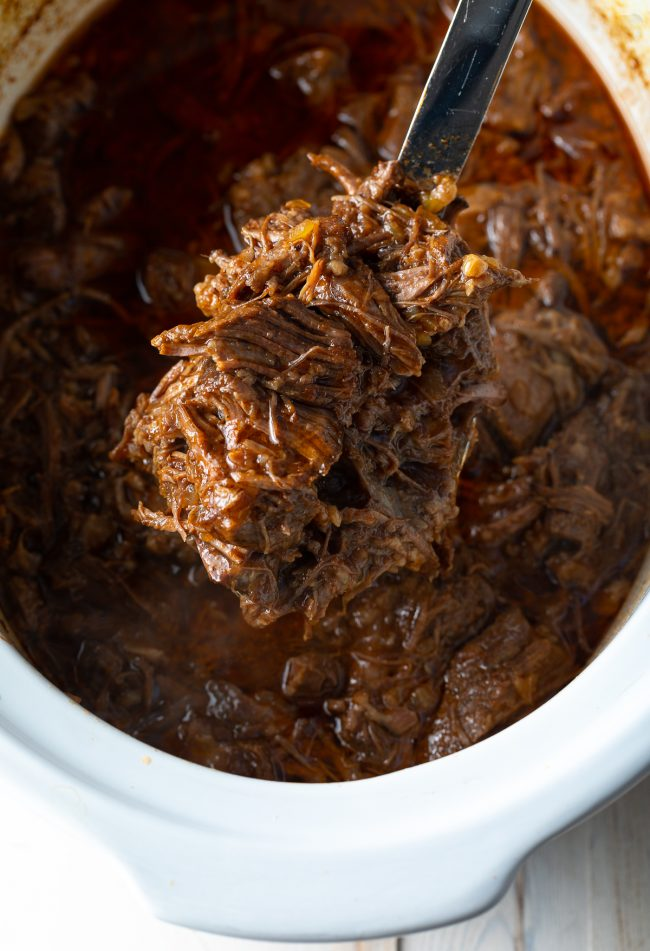 shredded roast beef in the slow cooker