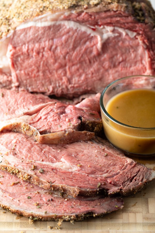 prime rib made in the smoker with a side of au jus beef gravy
