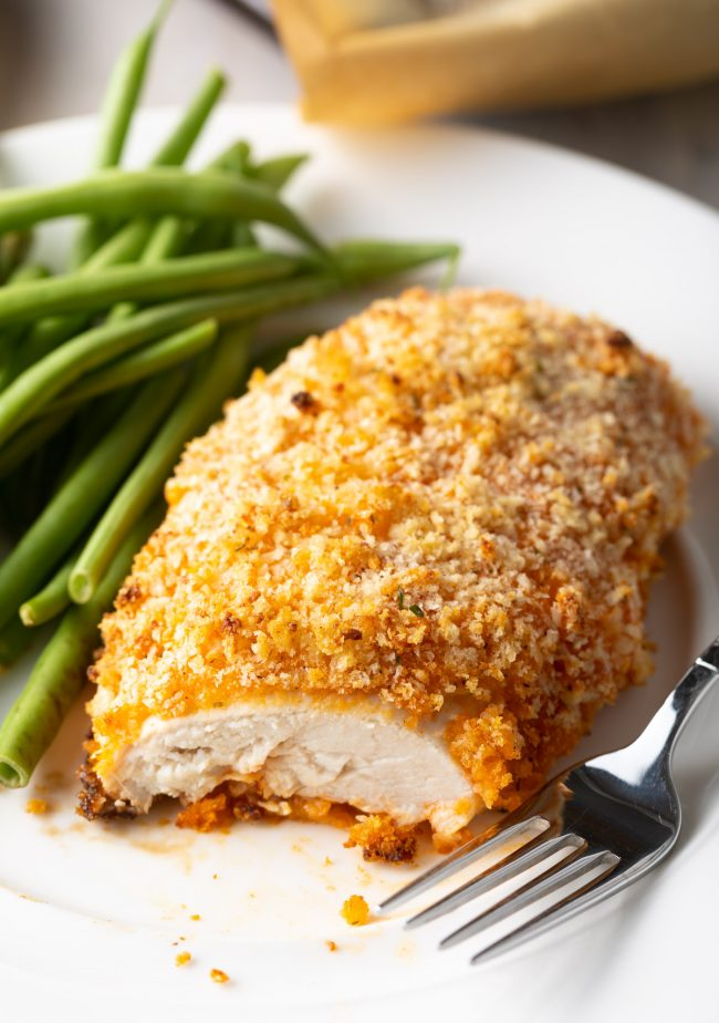 crispy crunchy baked chicken breast with buffalo sauce