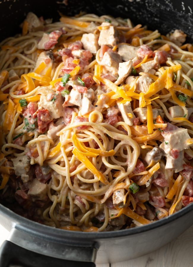 how to make chicken spaghetti with rotel and cheese