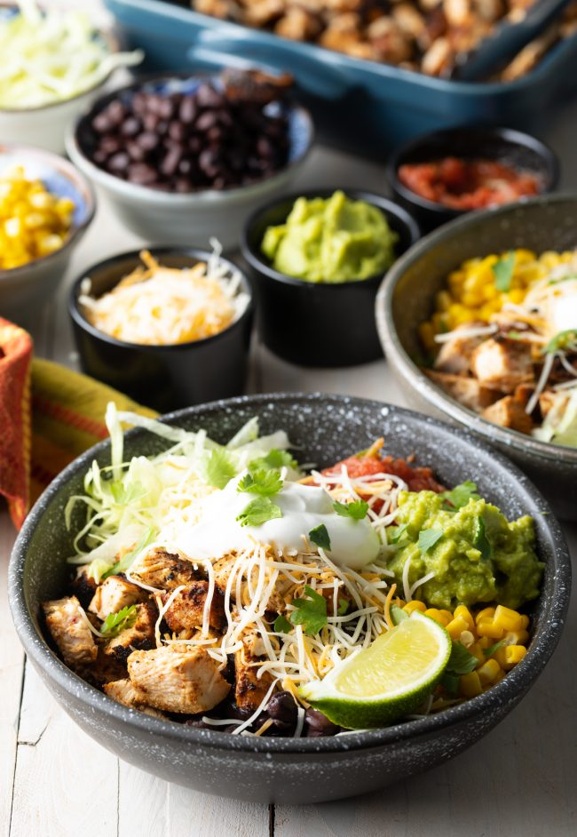 chicken chipotle rice bowl with toppings