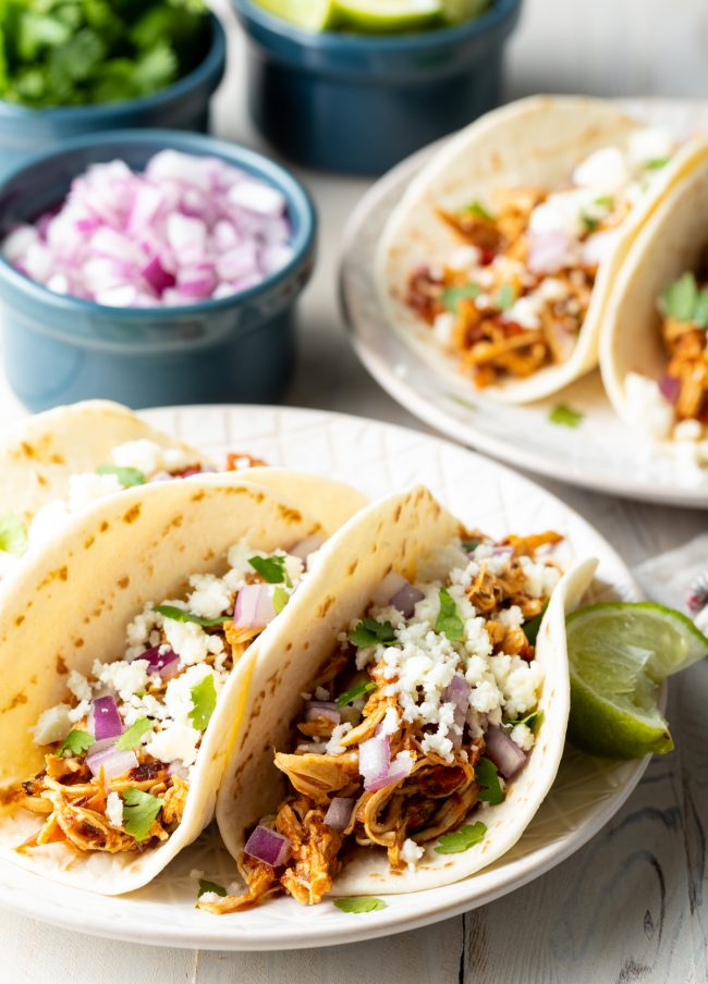 chicken tinga tacos loaded with toppings