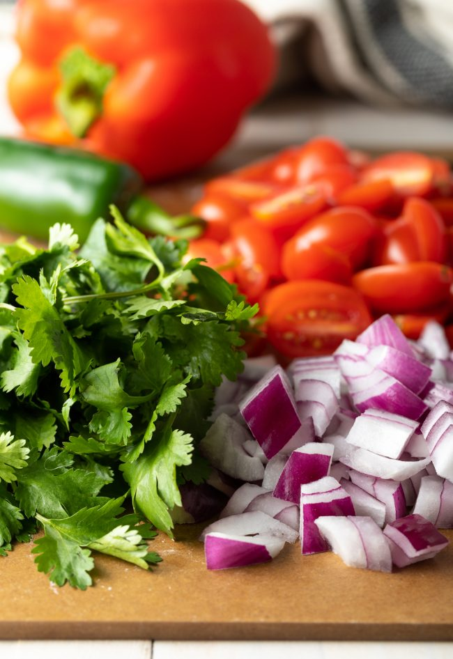 chopped cilantro, onion, tomatoes, peppers