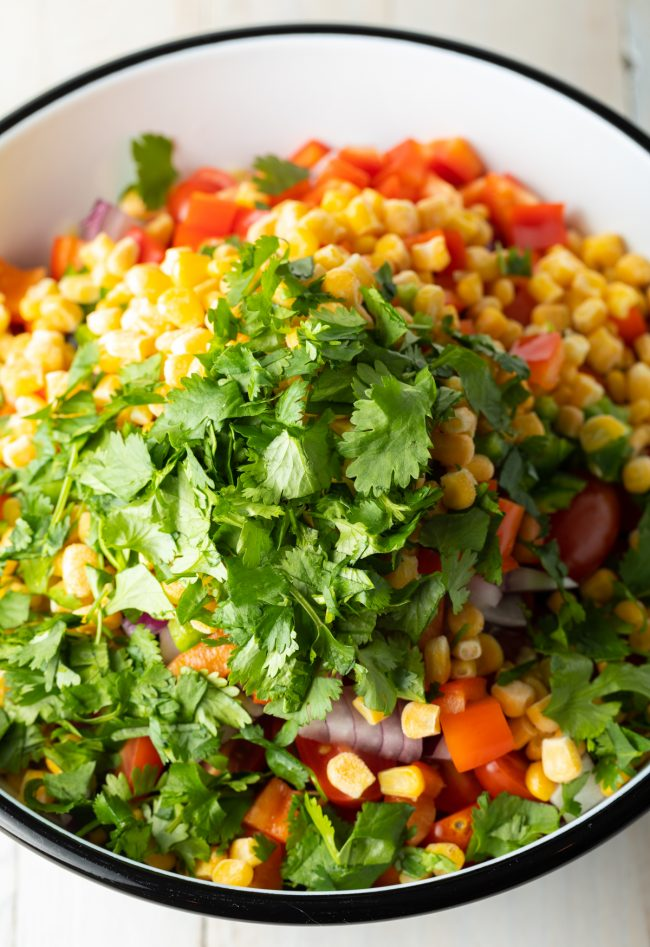 bowl of chopped southwest veggies, cilantro