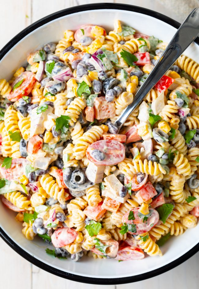 pasta salad with creamy ranch dressing, veggies, cilantro, and black beans