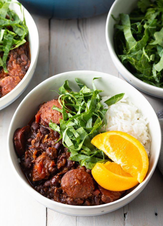 brazilian feijoada pork and black bean stew recipe with garnishes