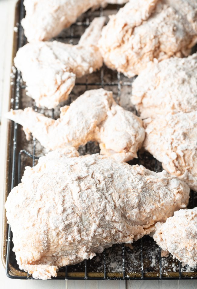 breaded thighs and breasts on a rack