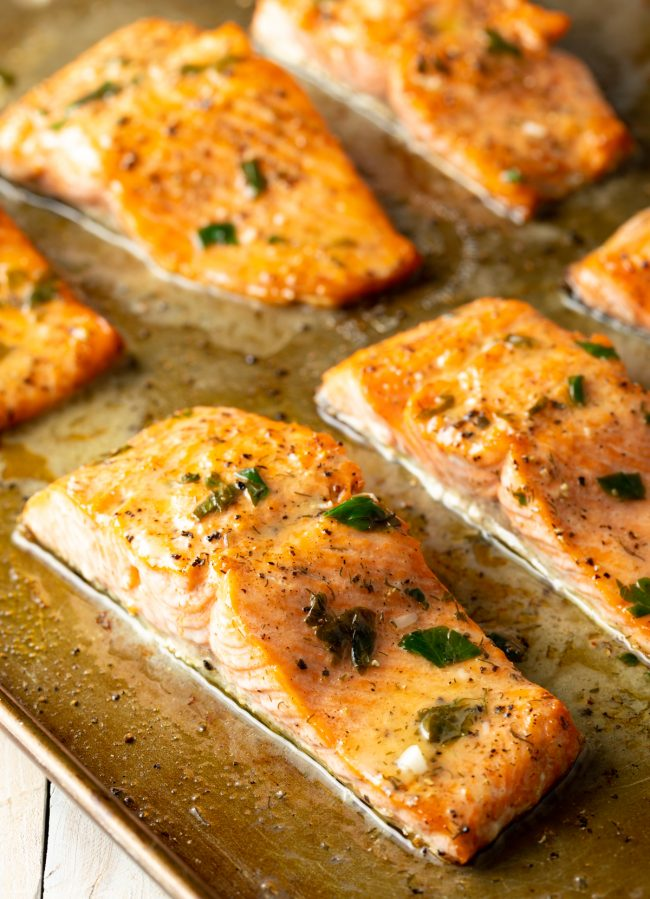 broiled salmon with parsley, dill, garlic butter
