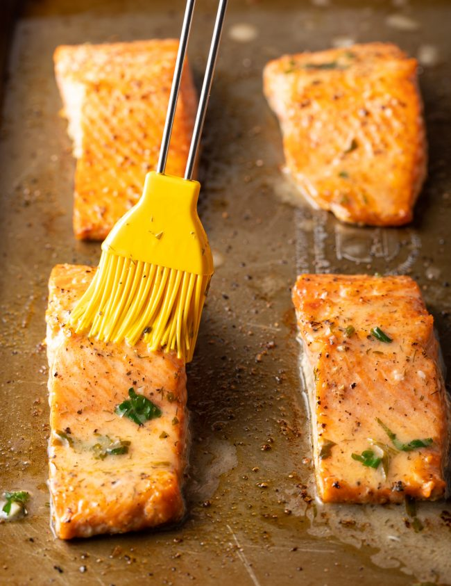 broiled salmon filets brushed with butter and herbs