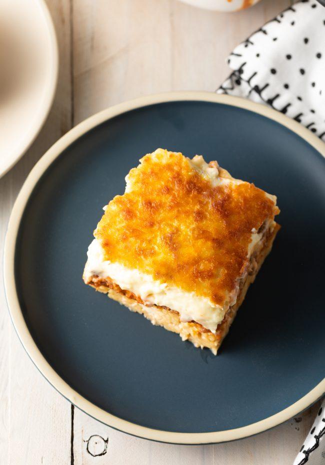 golden bechamel sauce on Greek lasagna