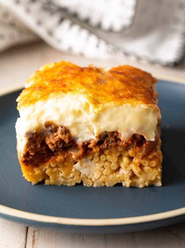 bucatini noodles, meat sauce, creamy baked beschamel Greek lasagna recipe