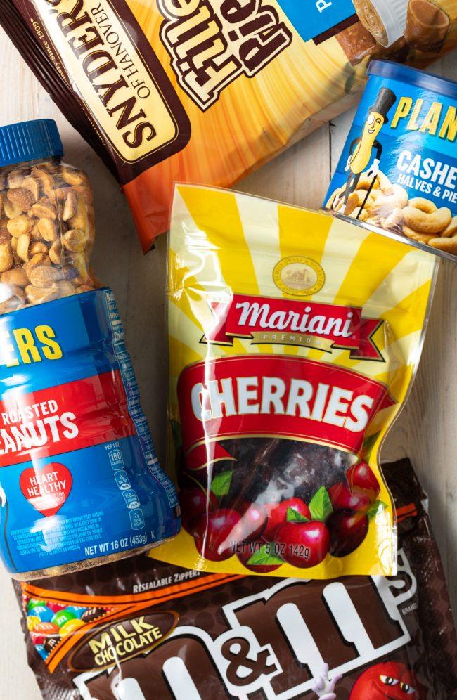 dried cherries, cashews, peanuts, pretzels, candies